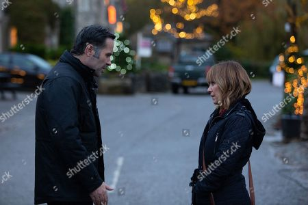 Ep 8677 Monday 16th December 2019 Graham Foster's, as played by Andrew Scarborough, worried he's losing Rhona Goskirk, as played by Zoe Henry, who's now determined to make her own decision about the job offer. However, Rhona softens after Graham reveals he's enrolled Leo in a football club which holds personal significance. After they both confess that they love one another they decide to accept the job offer and leave Emmerdale. Watched by Kim Tate, as played by Claire King.
