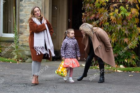 Stock Image of Ep 8671 Monday 9th December 2019 Kim Tate, as played by Claire King, packs Jamie Tate, Andrea Tate, as played by Anna Nightingale, and Mille Tate, as played by Willow Bell, off to Lapland.