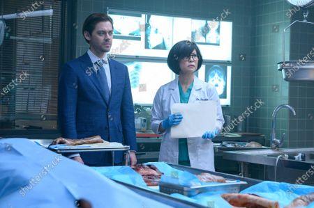 Tom Payne as Malcolm Bright and Keiko Agena as Dr. Edrisa Tanaka
