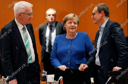 Stock Photo of German Chancellor Angela Merkel (C) listens to Baden-Wuerttemberg's State Premier Winfried Kretschmann (L) and Berlin Governing Mayor, Michael Mueller (R), during a meeting with premiers of federal states at the Chancellery in Berlin, Germany, 05 December 2019. The government meets with the federal heads of state to discuss, among others, the approval of a 60 million Euro package to fight antisemitism, protect Jewish life in Germany and preserve the Auschwitz-Birkenau memorial.