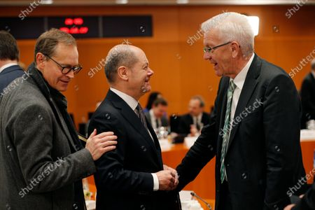 German Minister of Finance Olaf Scholz (C), greets Baden-Wuerttemberg's State Premier, Winfried Kretschmann (R), next to Berlin Governing Mayor, Michael Mueller (L), during a meeting with premiers of federal states at the Chancellery in Berlin, Germany, 05 December 2019. The government meets with the federal heads of state to discuss, among others, the approval of a 60 million Euro package to fight antisemitism, protect Jewish life in Germany and preserve the Auschwitz-Birkenau memorial.