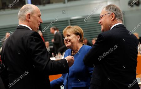 Premier of Lower Saxony Stephan Weil (R) listens to Premier of Brandenburg Dietmar Woidke (L) next to German Chancellor Angela Merkel (C), during a meeting with premiers of federal states at the Chancellery in Berlin, Germany, 05 December 2019. The government meets with the federal heads of state to discuss, among others, the approval of a 60 million Euro package to fight antisemitism, protect Jewish life in Germany and preserve the Auschwitz-Birkenau memorial.