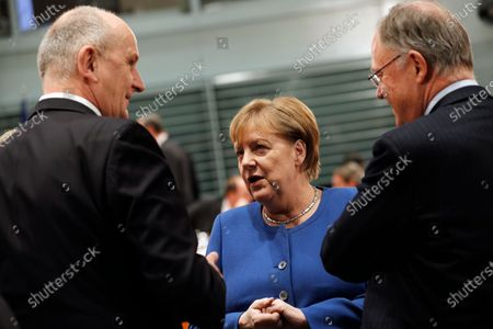 Stock Image of German Chancellor Angela Merkel (C) speaks with Premier of Lower Saxony Stephan Weil (R) and Premier of Brandenburg Dietmar Woidke (L), during a meeting with premiers of federal states at the Chancellery in Berlin, Germany, 05 December 2019. The government meets with the federal heads of state to discuss, among others, the approval of a 60 million Euro package to fight antisemitism, protect Jewish life in Germany and preserve the Auschwitz-Birkenau memorial.