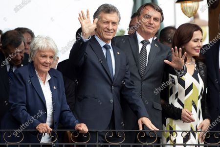 Uruguayan Vice President Lucia Topolansky (L), Argentine President Mauricio Macri (2-L), Brazilian President Jair Bolsonaro (2-R) and Bolivian interim Foreign Minister Karen Longaric (R), wave at the beginning of the Mercosur summit at the Spa de Vinho Hotel in Bento Goncalves, Brazil, 05 December 2019. Bolsonaro opened the semi-annual summit of Mercosur and reaffirmed the liberal course adopted by the block, on which he warned that 'it cannot accept ideological setbacks'. The summit, in which Paraguay will receive from Brazil the temporary presidency of the block, is held in Bento Goncalvez, in the southern state of Rio Grande do Sul, and has been preceded by technical meetings and foreign ministers.