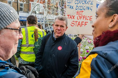 Stock Photo of PCS union members, from HMRC Ealing, stage a walk out and rally in opposition to the planned closure of their office by the end of 2020. They work in International House, Ealing, and voted overwhelmingly for strike action and action short of a strike. Mark Serwotka spoke at the rally.