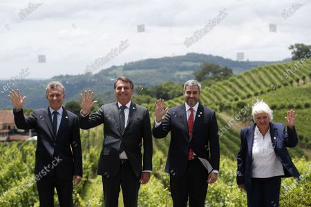 Argentine President Mauricio Macri (L), Brazilian President Jair Bolsonaro (2-L), Paraguayan President Mario Abdo Benitez (2-R), and Uruguayan Vice President Lucia Topolansky (R), pose for an official picture at the beginning of the Mercosur summit at the Spa de Vinho Hotel in Bento Goncalves, Brazil, 05 December 2019. Bolsonaro opened the semi-annual summit of Mercosur and reaffirmed the liberal course adopted by the block, on which he warned that 'he cannot accept ideological setbacks'. The summit, in which Paraguay will receive from Brazil the temporary presidency of the block, is held in Bento Gonçalvez, in the southern state of Rio Grande do Sul, and has been preceded by technical and foreign ministers meetings.