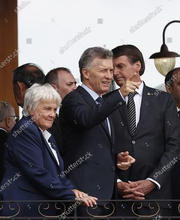Stock Picture of Uruguayan Vice President Lucia Topolansky (L), Argentine President Mauricio Macri (C), and Brazilian President Jair Bolsonaro (R) speak at the beginning of the Mercosur summit at the Spa de Vinho Hotel in Bento Goncalves, Brazil, 05 December 2019. Bolsonaro opened the semi-annual summit of Mercosur and reaffirmed the liberal course adopted by the block, on which he warned that 'he cannot accept ideological setbacks'. The summit, in which Paraguay will receive from Brazil the temporary presidency of the block, is held in Bento Gonçalvez, in the southern state of Rio Grande do Sul, and has been preceded by technical and foreign ministers meetings.
