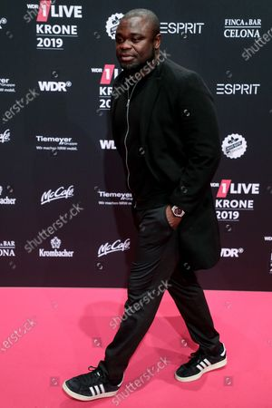 Ghanaian-born German former soccer player Gerald Asamoah poses at the 20th 1LIVE Krone radio awards ceremony at the Jahrhunderthalle in Bochum, Germany, 05 December 2019. The radio award 1LIVE Krone is given to the best national artists of the music industry.