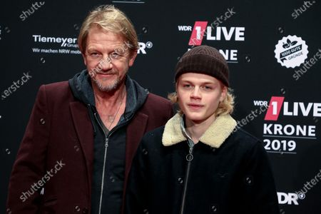 Stock Photo of German director and producer Soenke Wortmann (L) and his son Hugo (R) pose at the 20th 1LIVE Krone radio awards ceremony at the Jahrhunderthalle in Bochum, Germany, 05 December 2019. The radio award 1LIVE Krone is given to the best national artists of the music industry.