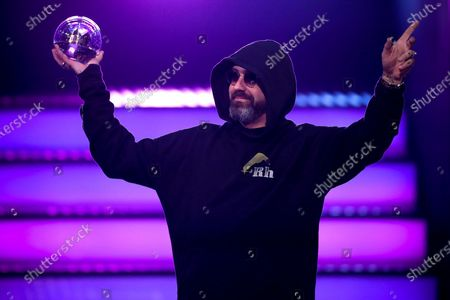 German rapper, actor and music producer Sido poses with his award 'Best Act' during the 20th 1LIVE Krone radio award at Jahrhunderthalle in Bochum, Germany, 05 December 2019. The radio award 1LIVE Krone is given to the best national artists of the music industry.