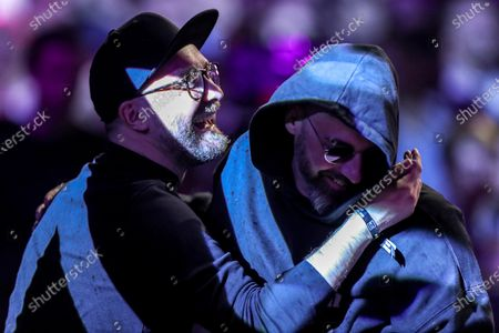 German singer songwriter Mark Forster (L) and German rapper, actor and music producer Sido (R) react during the 20th 1LIVE Krone radio award at Jahrhunderthalle in Bochum, Germany, 05 December 2019. The radio award 1LIVE Krone is given to the best national artists of the music industry.