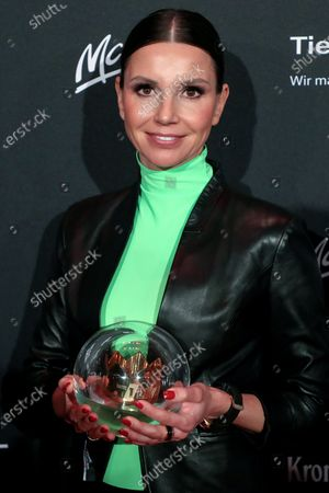 Stock Photo of Teresa Enke, widow of German national soccer goalkeeper Robert Enke and chairwoman of the Board of the Robert Enke Foundation, poses with her trophy after the 20th 1LIVE Krone radio awards ceremony at the Jahrhunderthalle in Bochum, Germany, 05 December 2019. The radio award 1LIVE Krone is given to the best national artists of the music industry.