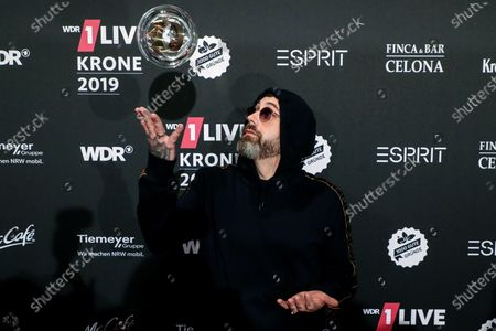 German rapper, actor and music producer Sido poses with his trophy after the 20th 1LIVE Krone radio awards ceremony at the Jahrhunderthalle in Bochum, Germany, 05 December 2019. The radio award 1LIVE Krone is given to the best national artists of the music industry.