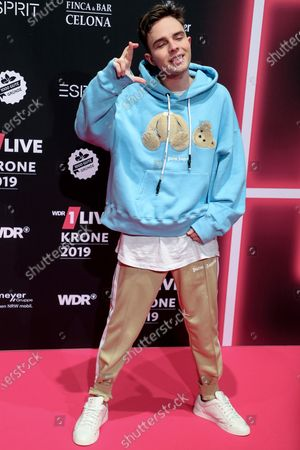 Stock Picture of German pop singer-songwriter Mike Singer poses at the 20th 1LIVE Krone radio awards ceremony at the Jahrhunderthalle in Bochum, Germany, 05 December 2019. The radio award 1LIVE Krone is given to the best national artists of the music industry.