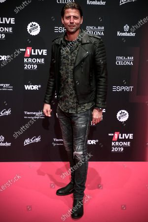 Former Borussia Dortmund goalkeeper Roman Weidenfeller poses at the 20th 1LIVE Krone radio awards ceremony at the Jahrhunderthalle in Bochum, Germany, 05 December 2019. The radio award 1LIVE Krone is given to the best national artists of the music industry.