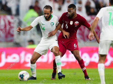 Abdullah Otayf (L) of Saudi Arabia  in action against Abdulaziz Hatem (R) of Qatar during the Arabian Gulf Cup semi final match between Qatar and Saudi Arabia at the Al Janoub Stadium in Al Wakrah Doha, Qatar on 05 December 2019.
