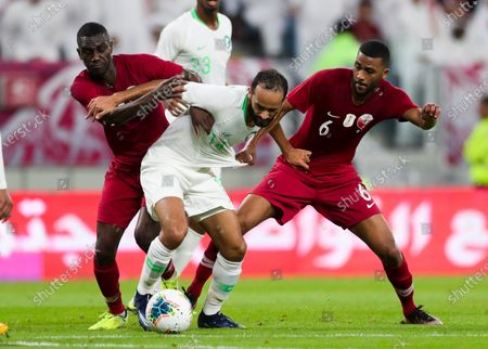 Abdullah Otayf (C) of Saudi Arabia  in action against Abdulaziz Hatem (R) and Almoez Ali (L) of Qatar during the Arabian Gulf Cup semi final match between Qatar and Saudi Arabia at the Al Janoub Stadium in Al Wakrah Doha, Qatar on 05 December 2019.