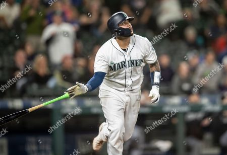 Stock Photo of Seattle Mariners' Omar Narvaez tosses his bat after hitting a solo home run off Chicago White Sox relief pitcher Alex Colome during the 10th inning of a baseball game, in Seattle. The Milwaukee Brewers acquired catcher Omar Narváez from the Seattle Mariners, for minor league pitcher Adam Hill and a compensation round pick in next June's amateur draft