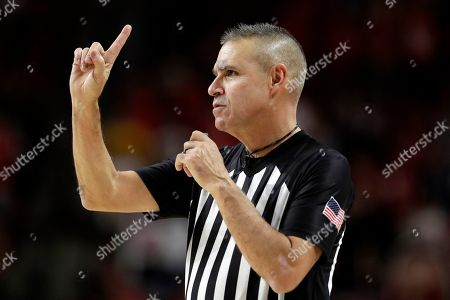 Stock Image of Referee Rob Riley gestures during the second half of an NCAA college basketball game between Maryland and Notre Dame, in College Park, Md. Maryland won 72-51
