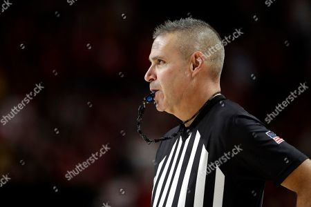 Stock Picture of Referee Rob Riley looks on during the second half of an NCAA college basketball game between Maryland and Notre Dame, in College Park, Md. Maryland won 72-51