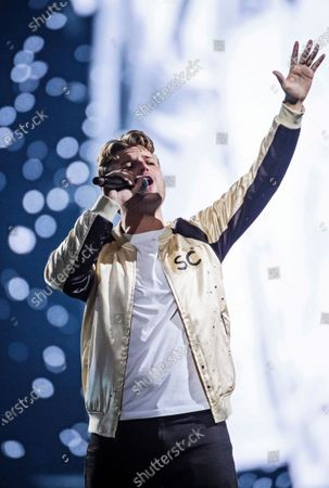 Sandro Cavazza performs on stage during the Avicii Tribute Concert For Mental Health Awareness at the Friends Arena in Stockholm, Sweden, 05 December 2019. Swedish musician, DJ, remixer and record producer Avicii (Tim Bergling) died at the age of 28 in Muscat, Oman on 20 April 2018.