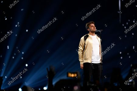 Swedish singer Sandro Cavazza performs on stage during the Avicii Tribute Concert For Mental Health Awareness at the Friends Arena in Stockholm, Sweden, 05 December 2019. Swedish musician, DJ, remixer and record producer Avicii (Tim Bergling) died at the age of 28 in Muscat, Oman on 20 April 2018.