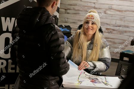 Skier Lindsey Vonn sign autographs at the grand opening of Big Snow in East Rutherford, N.J., . The facility, which is part of the American Dream mega-mall, is North America's first indoor ski and snowboard slope with real snow