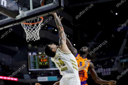 Real Madrid's Gabriel Deck (L) in action against Valencia Basket's Maurice Ndour (R) during a Euroleague basketball match between Real Madrid and Valencia Basket at the Wizink Center in Madrid, Spain, 05 December 2019.