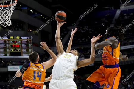 Real Madrid's Walter Tavares (C) in action against Valencia Basket's Bojan Dubljevic (L) and Maurice Ndour (R) during a Euroleague basketball match between Real Madrid and Valencia Basket at the Wizink Center in Madrid, Spain, 05 December 2019.