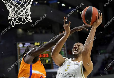 Real Madrid's Anthony Randolph (R) in action against Valencia Basket's Maurice Ndour (L) during a Euroleague basketball match between Real Madrid and Valencia Basket at the Wizink Center in Madrid, Spain, 05 December 2019.
