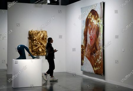 An art patron looks at 'Untitled' by Cindy Sherman during Art Basel in Miami, Florida, USA, 05 December 2019. Art Basel represents over 250 art galleries onsite at the Miami Beach Convention Center and is considered one of the world's largest art festivals with art events throughout the city.