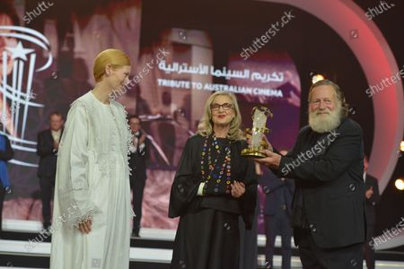 Tilda Swinton (L) presents the Tribute to Australian Cinema to Australian film director Gillian Armstrong (C) and Australian actor Jack Thompson (R) during the 18th annual Marrakech International Film Festival, in Marrakech, Morocco, 05 December 2019. The film festival runs from 29 November to 07 December 2019.