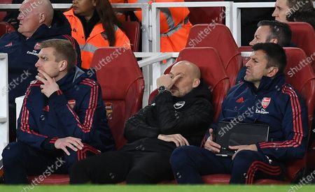 Arsenal caretaker manager Freddie Ljungberg (C) and assistant coaches Per Mertesacker (L) and Sal Bibbo (R) watches his team loose 2-1 to Brighton during an English Premier League soccer match in London, Britain, 05 December 2019.