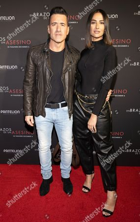 Jorge Bernal and Karla Birbragher posing at the Pantelion's En Brazos De Un Asesino Miami Premiere