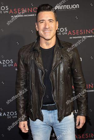 Jorge Bernal posing at the Pantelion's En Brazos De Un Asesino Miami Premiere