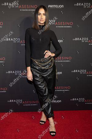 Karla Birbragher posing at the Pantelion's En Brazos De Un Asesino Miami Premiere