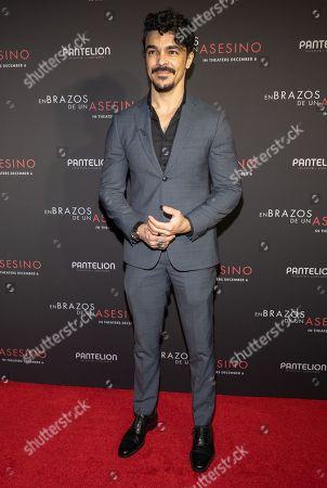 Shalim Ortiz posing at the Pantelion's En Brazos De Un Asesino Miami Premiere