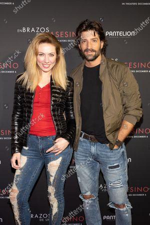 Stock Photo of Carolina Laursen and David Chocarro pose at the Pantelion's En Brazos De Un Asesino Miami Premiere