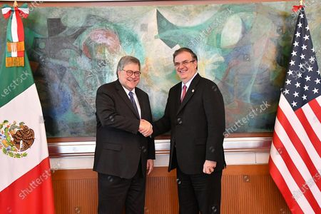 A handout photograph made available by the Ministry of Foreign Affairs shows Attorney General William Barr (L) and Mexican Foreign Secretary Marcelo Ebrard (R) posing for photos after a work meeting in Mexico City, Mexico, 05 December 2019. Mexico and USA agreed on 05 December to strengthen the High Security Group (Ganseg) with the objective of combating organized crime and cross border crime, according to the Mexican government said.