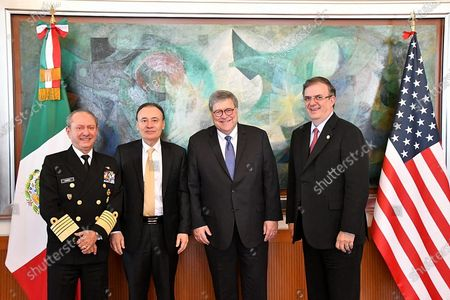 A handout photograph made available by the Ministry of Foreign Affairs shows (L-R), Secretary of the Navy Jose Rafael Ojeda, Secretary of Security and Citizen Protection Alfonso Durazo, Attorney General William Barr and Secretary of Foreign Affairs of Mexico Marcelo Ebrard posing for a photo after a work meeting in Mexico City, Mexico, 05 December 2019. Mexico and USA agreed on 05 December to strengthen the High Security Group (Ganseg) with the objective of combating organized crime and cross border crime, according to the Mexican government said.
