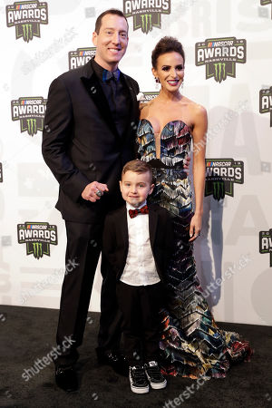 Stock Photo of Kyle Busch, Samantha Busch, Brexton Busch. Kyle Busch; his wife, Samantha; and son, Brexton, arrive for the NASCAR Cup Series Awards, in Nashville, Tenn