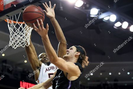Auburn center Austin Wiley (50) defends against a shot by Furman forward Clay Mounce (45) during the first half of an NCAA college basketball game, in Auburn, Ala