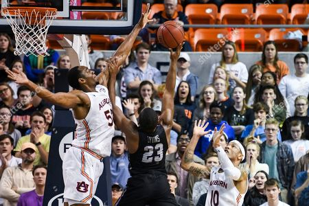 Stock Picture of Auburn center Austin Wiley (50) blocks a shot by Furman guard Jordan Lyons (23) during overtime of an NCAA college basketball game, in Auburn, Ala