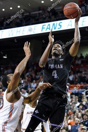 Furman forward Noah Gurley (4) shoots over Auburn center Austin Wiley (50) during the second half of an NCAA college basketball game, in Auburn, Ala