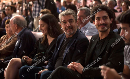 Stock Picture of Argentine actor and director Ricardo Darin, center, and his son Chino, attend the inauguration of the Havana Film Festival at the Karl Marx theater in Havana, Cuba