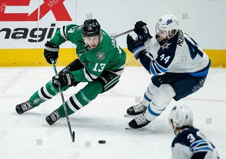 Mattias Janmark, Josh Morrissey. Dallas Stars forward Mattias Janmark (13) battles Winnipeg Jets defenseman Josh Morrissey (44) for space during the second period of an NHL hockey game, in Dallas. Dallas won 3-2 in overtime