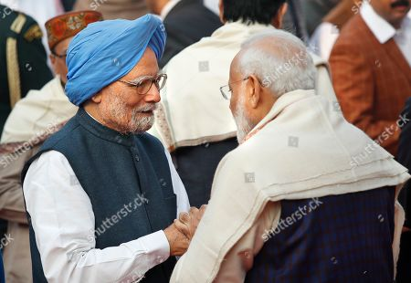 Indian Prime Minister Narendra Modi talks to his former Indian counterpart Manmohan Singh during a function to mark the death anniversary of B.R. Ambedkar at the parliament house, in New Delhi, . Ambedkar, who was known as the father of the Indian Constitution, was also a freedom fighter, social reformer and a politician