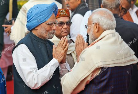 Indian Prime Minister Narendra Modi greets his former Indian counterpart Manmohan Singh at a function to mark the death anniversary of B.R. Ambedkar at the parliament house, in New Delhi, . Ambedkar, who was known as the father of the Indian Constitution, was also a freedom fighter, social reformer and a politician