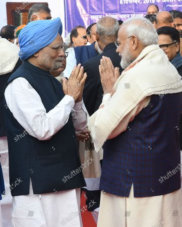 Indian prime minister Narendra Modi (R)  greets the former prime minister Manmohan Singh (L) at a ceremony held to mark the  death anniversary of Babasaheb Ambedkar, in Parliament House in New Delhi, India, 06 December 2019. India is observing the 63rd Mahaparinirvan Diwas, which marks the death anniversary of Dr Babasaheb Ambedkar, who is known as the father of the Indian Constitution.