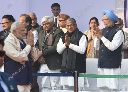 Indian prime minister Narendra Modi (L) greets the former prime minister Manmohan Singh (R) at a ceremony held to mark the  death anniversary of Babasaheb Ambedkar, in Parliament House in New Delhi, India, 06 December 2019. India is observing the 63rd Mahaparinirvan Diwas, which marks the death anniversary of Dr Babasaheb Ambedkar, who is known as the father of the Indian Constitution.